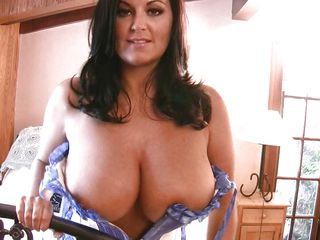 horny brunette with huge boobs showing off