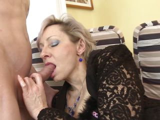 short haired mature bitch taking the taste of a young dick.