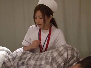 japanese nurse comforts her patient