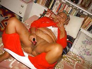 horny granny lies on the bed and masturbates