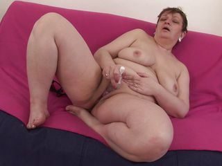 mature brunette lady masturbating on couch