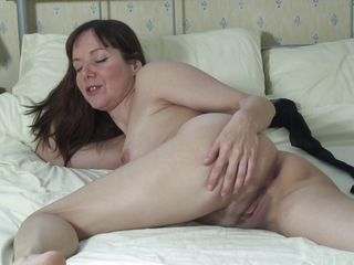sexy milf fingering her pussy to make it wet.