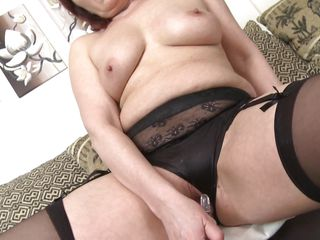 mature redhead likes her shinny toy