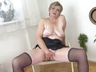 granny masturbates with black dildo