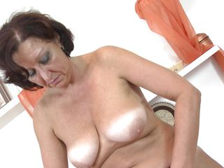 mature lady with floppy tits strips