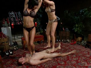 two dommes step on their slave