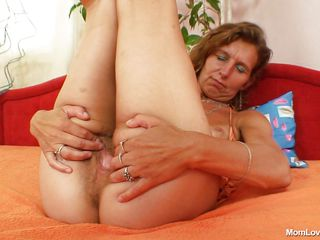 mature bitch masturbating with a dildo in the bedroom