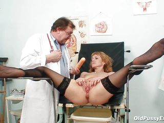 nora is getting her shaved pussy examined