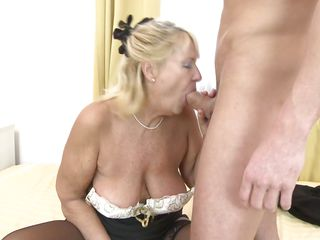 mature opens her mouth for a cock