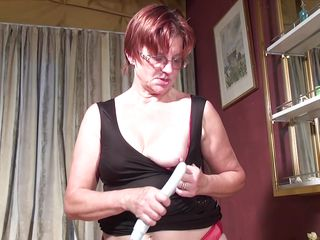 redheaded mature woman plays with a vibrator