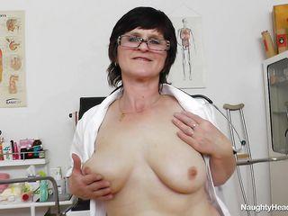 horny nurse examines herself
