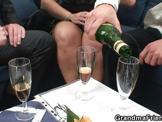 chunky granny celebrates with champagne and cock