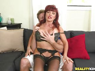 experienced redhead mommy happily bends over