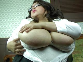 mature andrea plays with her ginormus boobs