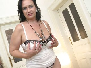 sexy mature slut shows off her saggy boobs
