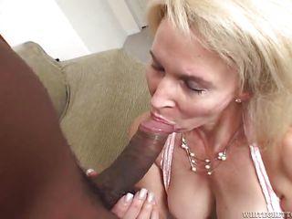 blonde granny gobbles down a white cock