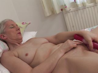 blonde granny fingering clit satisfying herself