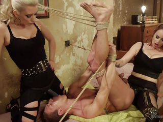 femdoms playing with tied guy