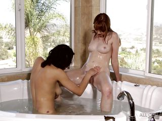 two girls playing in a hot tub