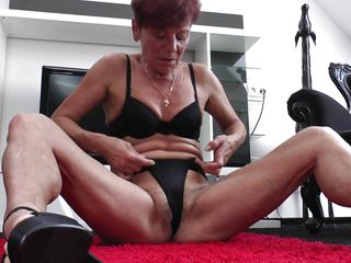 thin mature strokes her vagina