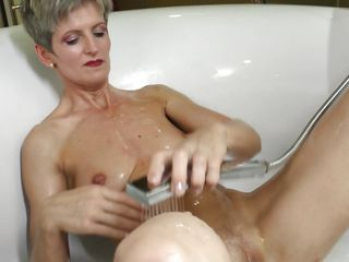 mature woman pleasures herself in the bathroom