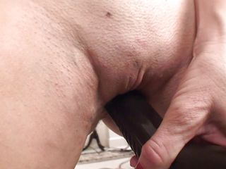 mature uses vacuum cleaner to satisfy her needs