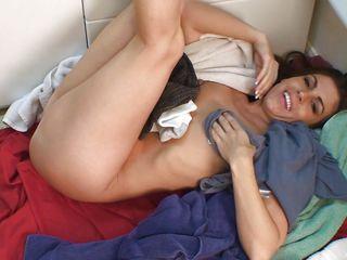 brunette rubs her hairy pussy