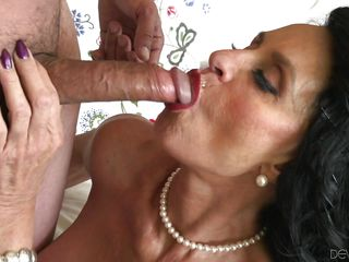 slutty mature bitch sucking dick