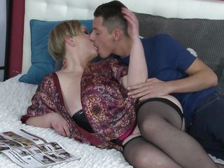 mature blonde sucking young stud's big cock
