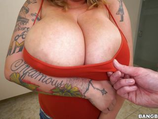 tattooed brunette gets her huge melons squeezed