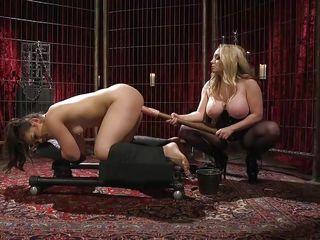 busty mistress fucks kimber woods with a huge dildo