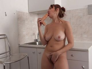 busty milf masturbates in the kitchen