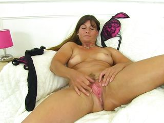 busty mature spreads her legs wide
