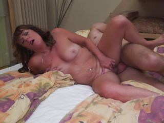 sexy mature woman moaning with pleasure