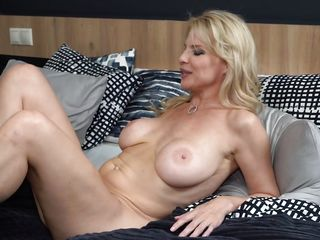 mature blonde uses her mouth and toes to make him cum